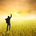 Happy Business Man Jumping In Yellow Rice Field And Sunset On Success Royalty Free Stock Photo - 57892085