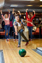 Happy Young Man Throwing Ball In Bowling Club Royalty Free Stock Photos - 57903158