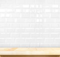 Empty Light Wood Table And White Ceramic Tile Brick Wall In Back Royalty Free Stock Photo - 57905605