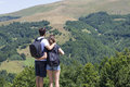 Couple Of Hikers With Backpacks Standing At Viewpoint And Enjoyi Royalty Free Stock Photography - 57921187