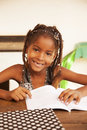 Happy African American Little Girl Studying Royalty Free Stock Images - 57929399