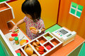 Chinese Children Role-playing At Burger Store. Stock Photos - 57931693