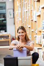 Smiling Customer With Cardboard Boxes Sitting In Stock Photography - 57933692