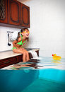 Child Girl Make Mess, Flooded Kitchen Imitating Swimming Pool, F Stock Images - 57937254
