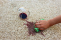 Glass Of Red Wine Fell On Carpet. Female Hand Cleans The Carpet Royalty Free Stock Photo - 58008565