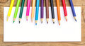 Color Pencils And White Paper On Wooden Royalty Free Stock Photo - 58012265
