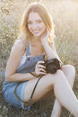 Happy Girl Making Pictures By Old Camera Stock Images - 58015384