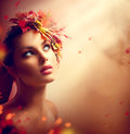 Romantic Autumn Girl With Colorful Leaves Royalty Free Stock Photography - 58017367