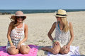 Day On The Beach - Two Women Sit On Sand Stock Images - 58047134