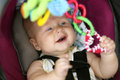 Happy Baby Girl Playing In Car Safety Seat Stock Photo - 58071950