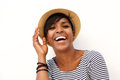 Attractive Young Black Woman Smiling With Hat Stock Photos - 58077333
