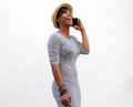 Smiling Young Woman Walking And Talking On Cell Phone Royalty Free Stock Photos - 58077618