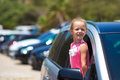 Little Adorable Girl In The Car Looking Throw Royalty Free Stock Image - 58090306
