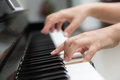 Woman Hands  Playing Piano Royalty Free Stock Photo - 58099205
