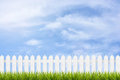 Grass And Fence Under Blue Sky And Clouds Stock Photos - 58117513