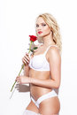 Sexy Blonde Woman In Underwear Holding Rose Stock Photography - 58137262