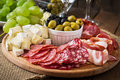 Antipasto Catering Platter With Bacon, Jerky, Salami, Cheese And Grapes Royalty Free Stock Photos - 58150828