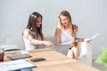 Two Business Woman Friendly Discussion During Royalty Free Stock Photo - 58169155