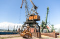 Port Crane With Scoop Loading Ship With Wheat Royalty Free Stock Photography - 58170917
