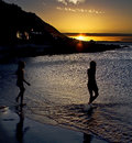 Stroll In The Ocean At Sunset Stock Photography - 5829302