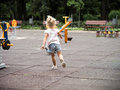 Blond Little Girl Running In The Playground Royalty Free Stock Image - 58215126