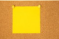 Yellow Post-it On A Coarkboard Background Stock Images - 58216644