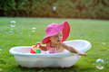 Little Girl Bathes In A Bath With Soap Bubbles Stock Images - 58234484