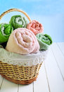 Different Colors Towels  In Wicker Basket Stock Photo - 58257130