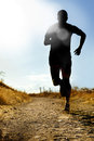 Full Body Silhouette Of Extreme Cross Country Man Running On Rural Track Jogging At Sunset Royalty Free Stock Photos - 58270938