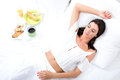 A Beautiful Young Woman Having Breakfast In Bed Stock Image - 58272381