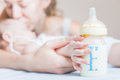 Baby Holding A Baby Bottle With Breast Milk Royalty Free Stock Photo - 58274525