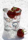 Water Glass Ice Cube And Strawberries Royalty Free Stock Image - 5830896