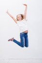 Happy Young Girl Jumping  On White Background Royalty Free Stock Photos - 58300408