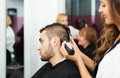 Barber Makes The Cut For Man Royalty Free Stock Photos - 58307348