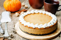 Pumpkin Cheesecake Decorated With Whipped Cream Royalty Free Stock Photography - 58313417