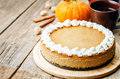 Pumpkin Cheesecake Decorated With Whipped Cream Stock Photo - 58313420