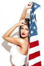 Sexy Brunette Woman Holding USA Flag Stock Photos - 58314353