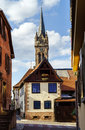 Very High Belltower Of Cathedral In Dambach La Ville, France Stock Image - 58333931