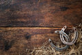 Two Old Rusty Horseshoes With Straw Royalty Free Stock Images - 58342979