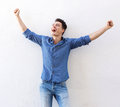 Cheerful Young Man With Raised Arms Celebrating Stock Photo - 58352230