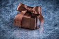 Boxed Gift With Tied Bow On Metallic Background Holiday Concept Stock Photography - 58360542