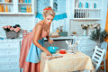 Girl In The Kitchen Reading Recipe  Book. Stock Photos - 58376213
