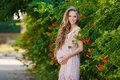 Beautiful Pregnant Woman In The Park Stock Photo - 58389050