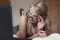 Sexy Surprised Blonde Student Reading Message On Laptop Royalty Free Stock Images - 58400439