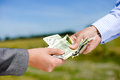 One Person S Hand Giving Some Money To Another Stock Images - 58434454