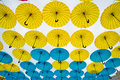 Bright Colorful Yellow And Blue Umbrellas Background Royalty Free Stock Image - 58445316