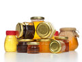 Sweet Tasty Jars Of Jam And Honey Cream In Row Composition With Royalty Free Stock Images - 58449769