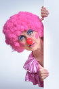 Female Clown Peeking Out From Behind Poster Paper Stock Photo - 58458580