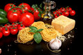 Round Balls Of Pasta With Cheese,tomatoes,basil,olive Oil On Black Royalty Free Stock Photos - 58464468