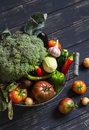 Fresh Garden Vegetables - Broccoli, Zucchini, Eggplant, Peppers, Beets, Tomatoes, Onions, Garlic - In Vintage  Metal Basket Royalty Free Stock Photography - 58483917